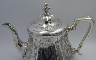 Victorian silver teapot with engraved panelled sides, creste...
