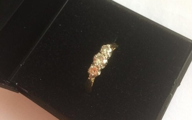 18ct yellow gold three stone diamond ring, stones total 0.33...