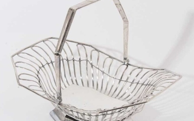 19th century silver plated cake basket of octagonal form with open wire frame and swing handle, raised on flared foot with pierced decoration, apparently unmarked, 34cm in overall length