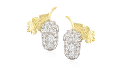 Description A PAIR OF DIAMOND EARRINGS Each designed as...
