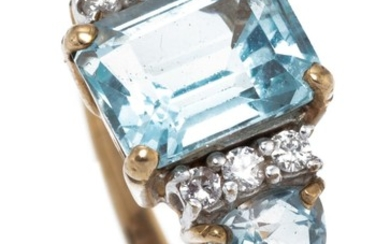 A 9CT GOLD TOPAZ AND DIAMOND RING; centring an approx. 3ct emerald cut blue topaz between shoulders each set with a pear cut blue to...