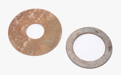 A Chinese mottled brown jade disk