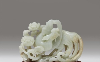 A Chinese pale celadon jade carving of a phoenix...