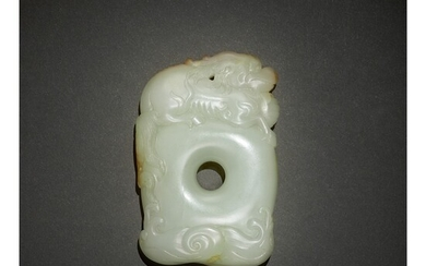 A FINE AND RARE WHITE AND RUSSET JADE 'QILIN' PENDANT, QING DYNASTY, QIANLONG PERIOD