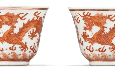 A FINE PAIR OF IRON-RED 'DRAGON' CUPS MARKS AND PERIOD OF GUANGXU