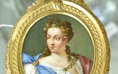 A GERMAN HAND PAINTED PORTRAIT MINIATURE ON PORCELAIN DEPICTING WOMAN IN GILT BRASS OVAL FRAME