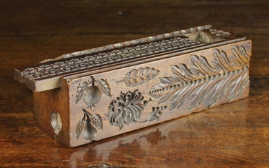 A Rare Antique Dug-out Treen Mould Box. The long, square section fruitwood block carved on all sides