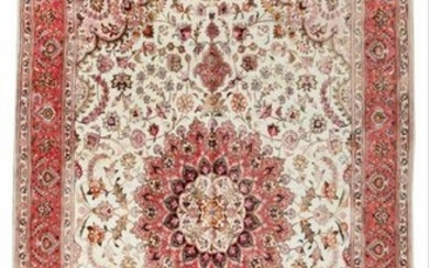 A Tabriz Wool And Silk Rug