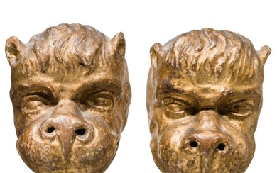A Tyrolese pair of carved and originally gilded Baroque lion heads, 18th century