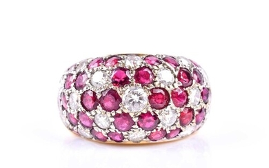 A diamond and ruby bombe style ring, the wide band set with ...