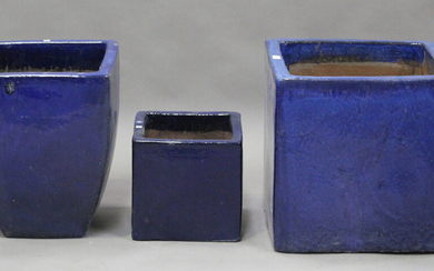 A large square modern blue glazed earthenware garden pot, height 49cm, width 50cm, together with two