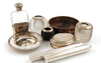 A mixed lot of silver items, various dates and makers, comprising: a modern cigar case, by Theo Fennell, London 1987, initialled, a Tiffany cigar case, a modern tobacco box by Asprey, London 1983, a wine coaster, two silver-mounted glass table vesta...