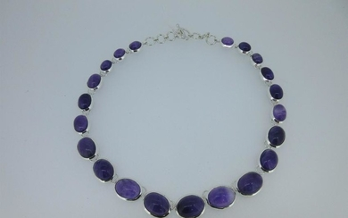 A modern silver necklace set with amethysts,