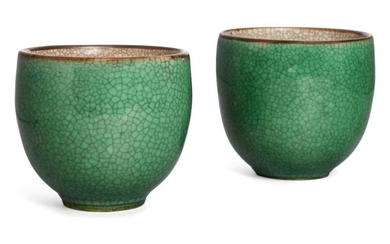 A pair of Chinese porcelain apple-green glazed...
