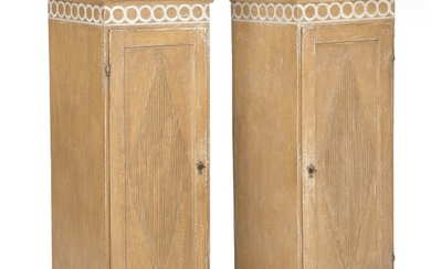 A pair of Gustavian style painted pedestal cabinets. 19th century and later. H. 137 cm. W. 50 cm. D. 48 cm. (2)