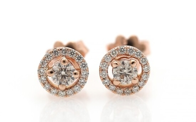 A pair of diamond ear studs each set with a diamond weighing a total of 0.40 ct., encircled by numerous brilliant-cut diamonds weighing a total of 0.35 ct.