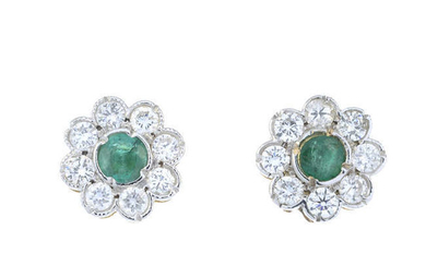 A pair of emerald and brilliant-cut diamond floral cluster earrings.