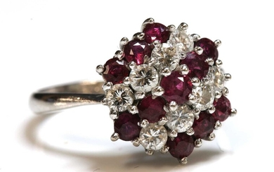 A white gold ruby and diamond hexagonal cluster ring