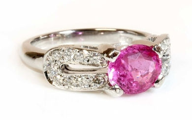 An 18ct white gold single stone pink sapphire ring