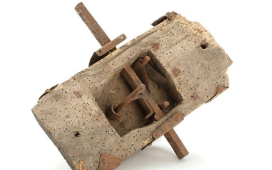 An 18th century Baroque iron door lock mounted to a piece of wood. H. 29. W. 13 cm.