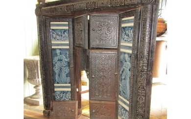 An aesthetic period cast iron fire surround with blue and wh...