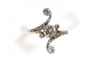 An antique 14k gold and silver diamond cross-over ring
