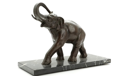 Artist unknown, 20th century: Standing elephant. A patinated bronze figure, mounted on a black marble base. H. incl. base 25 cm.