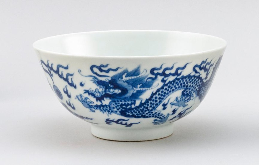 """CHINESE BLUE AND WHITE PORCELAIN BOWL Five-clawed dragon decoration. Six-character Kangxi mark on base. Diameter 6.3""""."""
