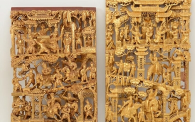 Chinese Gilt Relief Carvings. Two wooden panels with