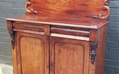Early Victorian Mahogany Chiffonier, with carved back, two cushion shaped drawers & two arched panel doors (H:150 W:120 D:46cm)
