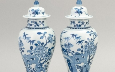 "PAIR OF CHINESE BLUE AND WHITE PORCELAIN COVERED JARS In inverted pear shape, with bird and flower decoration. Heights 9.25""."