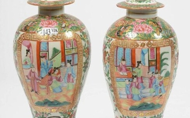 """Pair of small Canton polychrome porcelain vases decorated with """"Reserves animated"""" on a floral background. Chinese work. H.:+/-31cm."""