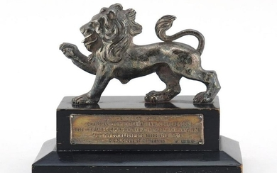 Silver model of a lion, presented to J K Chande, Kuala