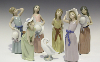 Six Lladro porcelain figures of young women with hats, including Naughty Girl, No. 5006, Bashful, No