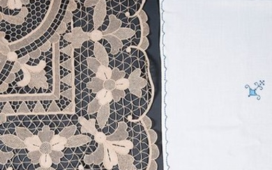 Tablecloth in white thread with cross-stitch decoration of...