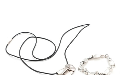 """NOT SOLD. Toftegaard: A sterling silver """"Stream"""" bracelet and pendant. Kautschuk rubber and sterling silver..."""