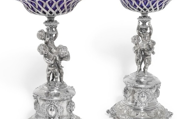 A PAIR OF VICTORIAN PARCEL-GILT SILVER COMPORTS, ALEXANDER MACRAE FOR HARRY EMMANUEL, LONDON, 1859