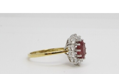 18ct gold oval ruby and diamond cluster ring. Diamonds 1,00c...