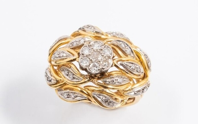 18k (750 thousandths) yellow gold dome ring set with a central flower of seven 8x8 cut diamonds surrounded by foliage outlined in 18k (750 thousandths) white gold and small diamonds. Beautiful work from the 1950s.