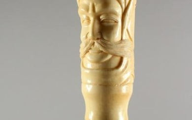 A BONE HANDLED WALKING STICK, carved as a bust of a