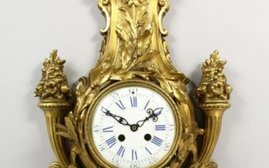 A BRONZE CASED CARTEL WALL CLOCK, with white porcelain