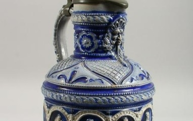 A CONTINENTAL STONEWARE JUG, with blue glazed, moulded