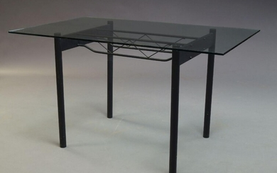 A Contemporary glass and black anodised steel dining table, with...
