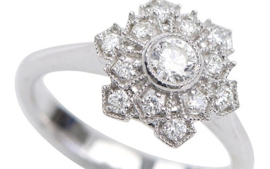 A DIAMOND DRESS RING - Of snowflake design, set with round brilliant cut diamonds totalling 0.51cts, in 18ct white gold, ring size N.