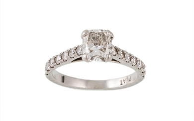 A DIAMOND SOLITAIRE RING, with cushion cut centre stone of a...