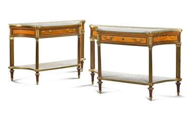A MATCHED PAIR OF FRENCH GILT-BRONZE AND BRASS MOUNTED SATINWOOD AND AMARANTH CONSOLE DESSERTES, ONE LATE LOUIS XVI, CIRCA 1790, THE OTHER OF A LATER DATE