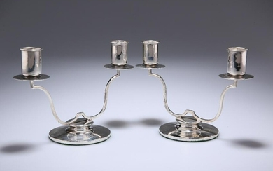 A PAIR OF GEORGE VI SILVER TWO-LIGHT CANDELABRA
