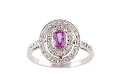 A PINK SAPPHIRE AND DIAMOND CLUSTER RING, the oval sapphire ...