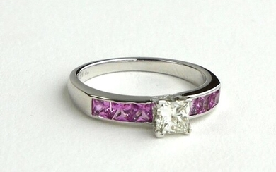 A PLATINUM RING SET WITH CENTRAL PRINCESS CUT DIAMOND ON PIN...