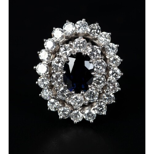 A SAPPHIRE AND DIAMOND CLUSTER RING in 18ct white gold claw ...
